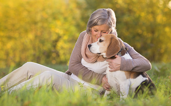 Woman hugging dog